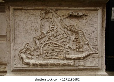 VENICE, ITALY - AUG 10, 2018 - Bas Relief map of fortifications of the city of Padua on exterior of church in Venice, Italy