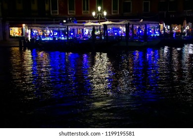 VENICE, ITALY - AUG 10, 2018 - Nighttime diners at a restaurant in Venice, Italy