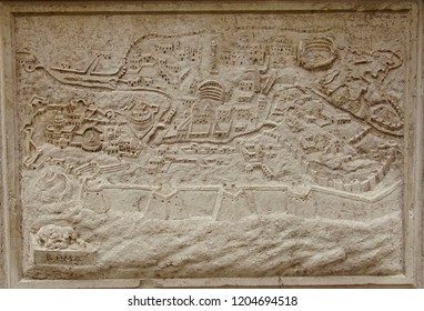 VENICE, ITALY - AUG 10, 2018 - Bas Relief map of fortifications of the city of Rome on exterior of church in Venice, Italy