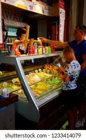 VENICE, ITALY - AUG 10, 2018 - Tourists order gelato ice cream in Venice, Italy