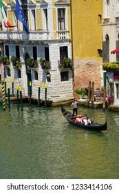 VENICE, ITALY - AUG 10, 2018 - Gondolas in the Grand Canal near the Rialto Bridge in Venice, Italy