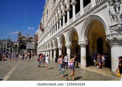 VENICE, ITALY - AUG 10, 2018 - Tourist stroll in piazza near  the Doge's Palace in Venice, Italy