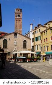 VENICE, ITALY - AUG 10, 2018 - Tables in an Italian restaurant trattoria, Venice, Italy