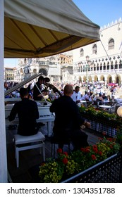 VENICE, ITALY - AUG 10, 2018 - Free Jazz and classical music mixes  at lunchtime on the  Piazza San Marco, Venice, Italy