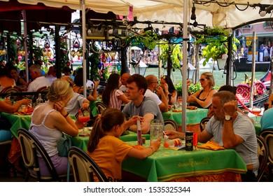 VENICE, ITALY - AUG 10, 2018 - Night scene in restaurant under the Rialto Bridge in Venice, Italy