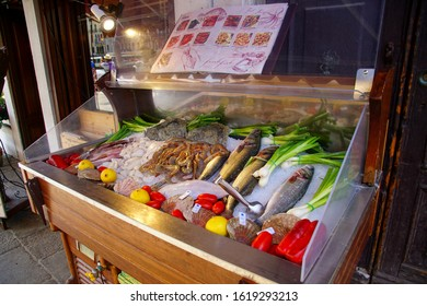 VENICE, ITALY - AUG 10, 2018 - Shrimp scampi and other seafood on display in a restaurant in Venice, Italy
