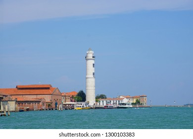 VENICE, ITALY - AUG 11., 2018 - Lighthouse on the island of Murano, Venice, Italy