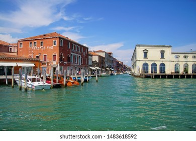 VENICE, ITALY - AUG 11, 2018 - Small boats and buildings along the canals of Venice, Italy