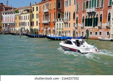 VENICE, ITALY - AUG 12, 2018 - Carabinieri police boat speeds along the Grand Canal of Venice, Italy