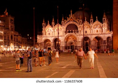 VENICE, ITALY - AUG 12, 2018 - San Marco cathedral in the piazza at night, Venice, Italy