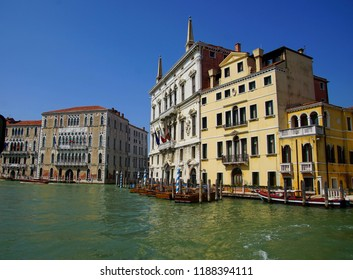VENICE, ITALY - AUG 12, 2018 - Water taxis tied up before a palace on the Grand Canal, Venice, Italy