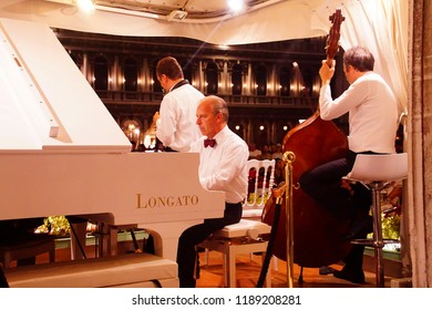 VENICE, ITALY - AUG 12, 2018 - Outdoor concert at a restaurant on Piazza San Marco, Venice, Italy