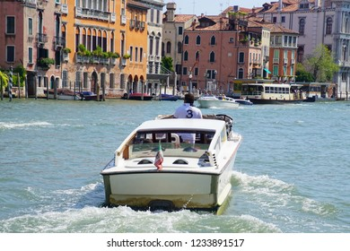 VENICE, ITALY - AUG 12, 2018 - Water taxi boat in the Grand Canal of Venice, Italy