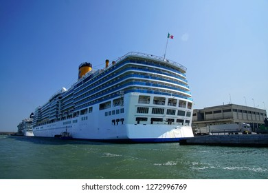 VENICE, ITALY - AUG 12, 2018 - Huge cruise ships at anchor in Tronchetto of Venice, Italy