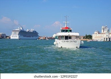 VENICE, ITALY - AUG 12, 2018 - Vaporetto transit boat in lagoon harbor of Venice, Italy
