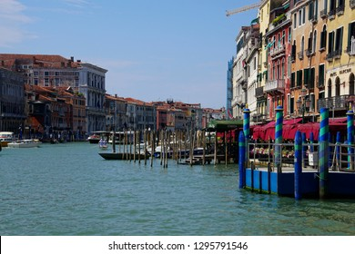 VENICE, ITALY - AUG 12, 2018 - Scull rowers compete with other water traffic on the Grand Canal, Venice, Italy