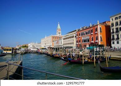 VENICE, ITALY - AUG 12, 2018 - Gondolas with tourists near the Doge's Palace, Venice, Italy