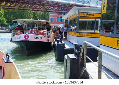 VENICE, ITALY - AUG 12, 2018 - Tourists on a Vaporetto transport  on the Grand Canal of Venice, Italy