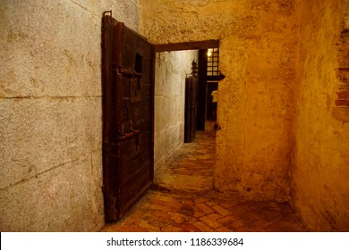 VENICE, ITALY - AUG 13, 2018 - Prison cell in the dungeons of the Doge's Palace in Venice, Italy