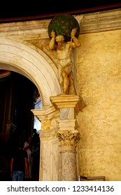 VENICE, ITALY - AUG 13, 2018 - Staute of Atlas holding up the world in the Doge's Palace in Venice, Italy