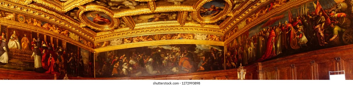 VENICE, ITALY - AUG 13, 2018 - Historical paintings on walls of huge golden meeting hall in the Doge's Palace in Venice, Italy
