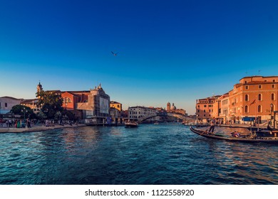 Venice, Italy - August 04, 2017: View of Grand canal in Venice and torists in Gondolas at sunset