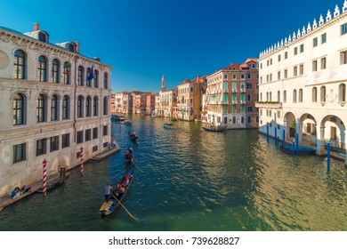 Venice, Italy - August 04, 2017: View of Grand canal in Venice and tourists in Gondolas