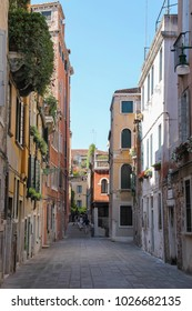 Venice, Italy - August 13, 2016: Tourists on narrow street of historic center in Venice, San Marco