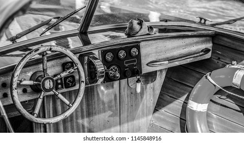 VENICE, ITALY - AUGUST 19, 2016: High-speed passenger retro style boat on the Venetian channels on August 19, 2016 in Venice, Italy.