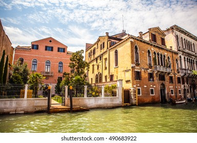 VENICE, ITALY - AUGUST 19, 2016: Famous architectural monuments and colorful facades of old medieval buildings close-up on August 19, 2016 in Venice, Italy.