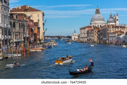 Venice, Italy, August 2017: Grand Canal panorama with boats and gondola, beautiful palazzos on a sunny day