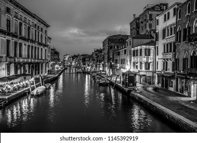 VENICE, ITALY - AUGUST 21, 2016: Famous architectural monuments, ancient streets and facades of old medieval buildings at night time. Black-white photo. August 21, 2016 in Venice, Italy.