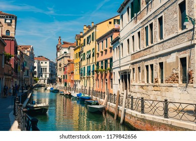Venice, Italy - August 22 2018:  Traditional canal street with boats in Venice, Italy.