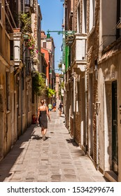 Venice, Italy - August 26, 2009: A narrow street of old Venice