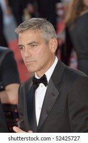 VENICE, ITALY - AUGUST 27: George Clooney greets fans as he arrives at the opening ceremony and 'Burn After Reading' Premiere during the 65th Venice Film Festival on August 27, 2008 in Venice, Italy