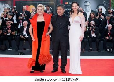 "VENICE, ITALY - AUGUST 28: Catherine Deneuve, Hirokazu Koreeda and Juliette Binoche attend the premiere of the movie ""La Vérité"" during the 76th Venice Film Festival on August 28, 2019 in Venice."