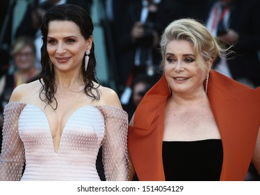 """VENICE, ITALY - AUGUST 28: Juliette Binoche and Catherine Deneuve walks the red carpet of """"La Vérité"""" (The Truth) screening during the 76th Venice Film Festival on August 28, 2019"""