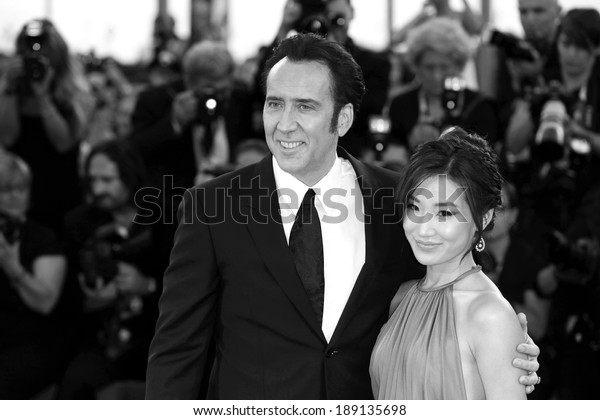 VENICE, ITALY - AUGUST 30: Actor Nicolas Cage and his wife Alice Kim attend 'Joe' Premiere during The 70th Venice  Film Festival on August 30, 2013 in Venice, Italy