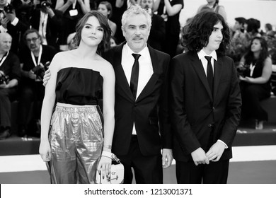 VENICE, ITALY - AUGUST 30: Tess Bu Cuaro—n, Alfonso Cuaro—n and Olmo Teodoro Cuar—on walk the red carpet of the movie 'Roma' during the 75th Venice Film Festival on August 30, 2018 in Venice, Italy