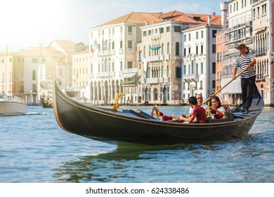 Venice, Italy - August 31, 2013. Gondolier transporting tourists in Venice. Italy.