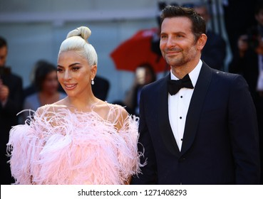 VENICE, ITALY - AUGUST 31: Bradley Cooper and Lady Gaga walk the red carpet ahead of the 'A Star Is Born' screening during the 75th Venice Film Festival on August 31, 2018 in Venice, Italy
