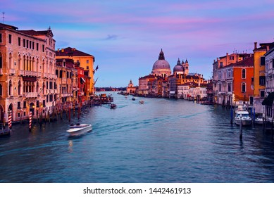 Venice, Italy. Basilica Santa Maria della Salute located at Grand Canal in Venice, Italy. Famous touristic landmark at sunset with colorful sky