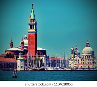Venice in Italy bell tower of Saint George Church and the Dome of the Basilica of Madonna della Salute from the boat with vintage effect