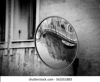 Venice (Italy) Canal and embankment reflected in street mirror. Black and white.