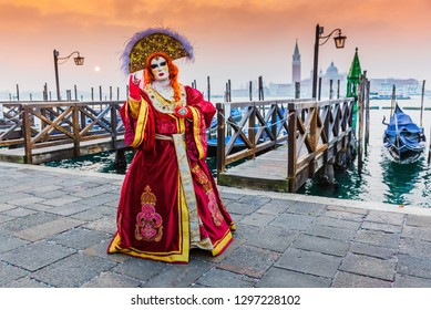 Venice, Italy. Carnival of Venice, beautiful mask at St. Mark's Square.