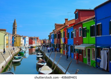 """VENICE, ITALY - CIRCA JUNE 2015 - My first journey in the Burano island, the city of colours in the lagoon of Venice.  A """"mystical"""" promenade amongst canals, houses and tourists."""