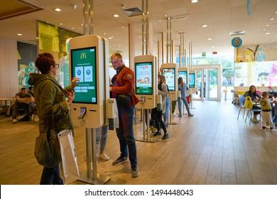 VENICE, ITALY - CIRCA MAY, 2019: people use self-service kiosk inside McDonald's restaurant in Venice..