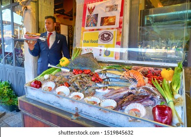 VENICE, ITALY - CIRCA MAY, 2019: seafood on display at a restaurant in Venice.