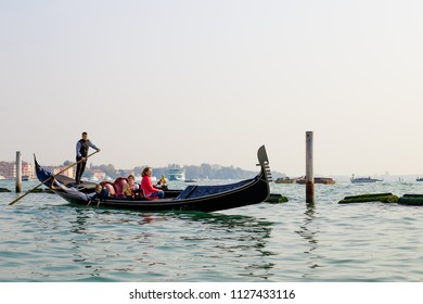 VENICE, ITALY - CIRCA OCT 2017: Gondola with tourists on the Grand Canal, Venice, Italy. Gondolier with tourists sails on a Venetian canal.