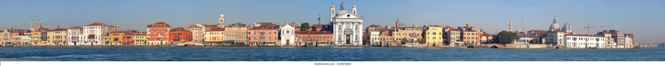 VENICE, ITALY - DECEMBER 19, 2012: Long Waterfront Cityscape Giudecca Canal Houses in Venice, Italy.